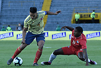 BOGOTA - COLOMBIA, 03-06-2019: Falcao Garcia jugador de Colombia disputa el balón con Armando Cooper jugador de Panamá durante partido amistoso entre Colombia y Panamá jugado en el estadio El Campín en Bogotá, Colombia. / Falcao Garcia player of Colombia fights the ball with Armando Cooper player of Panama during a friendly match between Colombia and Panama played at Estadio El Campin in Bogota, Colombia. Photo: VizzorImage/ Gabriel Aponte / Staff