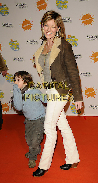 "ANDREA CATHERWOOD & KID.At the ""Spongebob Squarepants - The Sponge who could Fly"" Gala performance at the Hammersmith Apollo, London, England. .March 5th 2009 .full length sheepskin fur jacket cream brown white jeans denim children black blue .CAP/CAN.©Can Nguyen/Capital Pictures."