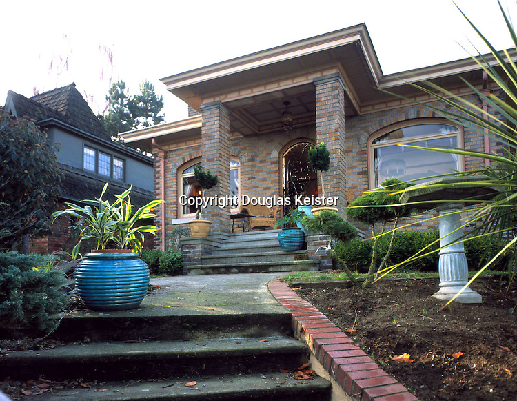 Seattle, Washington. 1925.  This Mediterranean style, brick bungalow was built with bootleg gin profits by a crooked, Seattle judge as a reward for a local police lieutenant who helped him supply speakeasies during Prohibition.  Even the judge must have felt it was ironic that he was later arrested, caught smuggling the illegal hooch by a photographer from the bungalow's living room window!  The house was still remarkably intact when the current owners bought it in 1981 and they had to make only minor, cosmetic repairs.