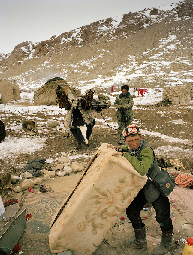 "Nassim packs his yurt. His young wife died recently. He himself almost died from pneumonia. He must move to his brother's campment with his young daughter so his wife's brother takes care of him..Campment of the ""second"" Sary Tash. Ustad's Ghulam's camp..Winter expedition through the Wakhan Corridor and into the Afghan Pamir mountains, to document the life of the Afghan Kyrgyz tribe. January/February 2008. Afghanistan"
