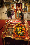 Flower enshrined icon of the cross at the iconostasis during the Exaltation (Elevation) of the Holy Cross service, inside the Church of the Ascension of Jesus Christ at the Monastery Mileševa, Serbia originally built in the 13th century.