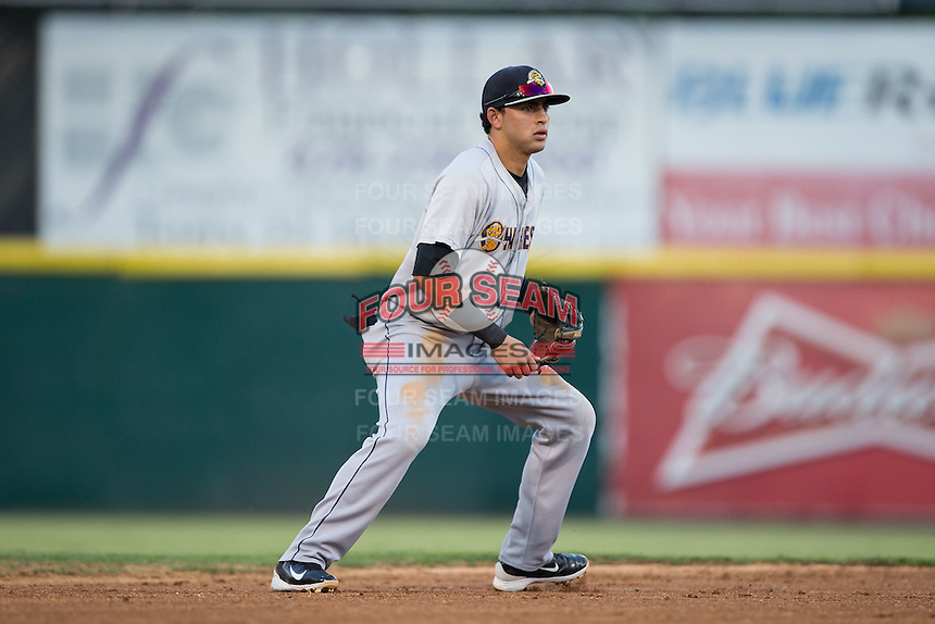 Charleston RiverDogs shortstop Angel Aguilar (7) on defense against the Hickory Crawdads at L.P. Frans Stadium on August 25, 2015 in Hickory, North Carolina.  The Crawdads defeated the RiverDogs 7-4.  (Brian Westerholt/Four Seam Images)