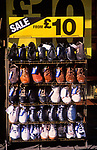 A728JF Shoe shop sale display with pairs at £10 each British high street shopping