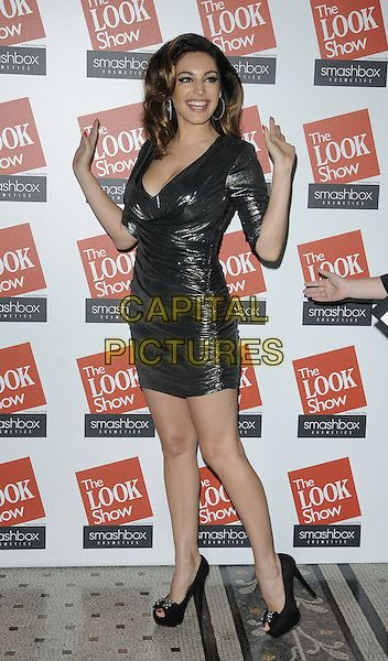 Kelly Brook.attended the Look Show in association with Smashbox cosmetics, Royal Courts of Justice, The Strand, London, England, 6th October 2012..full length silver shiny ruched lame dress hands waving  tight black peep toe shoes cleavage .CAP/CAN.©Can Nguyen/Capital Pictures.