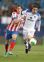 Getafe's Pedro Leon against Atletico de Madrid's Filipe Luis during King's Cup match. December 12, 2012. (ALTERPHOTOS/Alvaro Hernandez) /NortePhoto