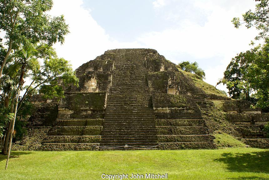 Great Pyramid in the Mundo Perdidio or Lost World complex, Maya ruins of Tikal, El Peten, Guatemala. Tikal is a UNESCO World Heritage Site....