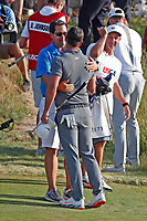 Brooks Koepka (USA) is congratulated by his father on the 18th green after winning the 118th U.S. Open Championship at Shinnecock Hills Golf Club in Southampton, NY, USA. 17th June 2018.<br /> Picture: Golffile | Brian Spurlock<br /> <br /> <br /> All photo usage must carry mandatory copyright credit (&copy; Golffile | Brian Spurlock)