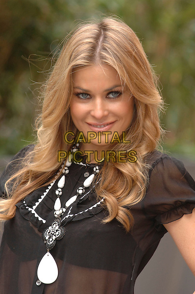 "pictures supplied by Steve Finn.CARMEN ELECTRA.Photocall for ""Scary Movie 4"" at the St. Martin's Lane Hotel, London, UK..April 13th, 2006.Ref: FIN.headshot portrait white beaded necklace.www.capitalpictures.com.sales@capitalpictures.com.© Capital Pictures."