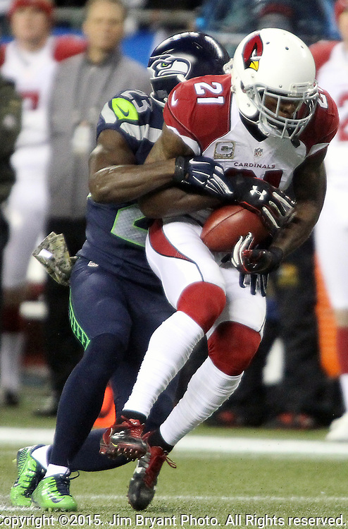 Seattle Seahawks  free safety Steven Terrell (23) brings down  Arizona Cardinals Patrick Peterson (21) during a punt return at CenturyLink Field in Seattle, Washington on November 15, 2015. The Cardinals beat the Seahawks 39-32.   ©2015. Jim Bryant photo. All Rights Reserved.