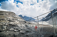 Crossing a hanging bridge to Cabane de Pannosière, Val de Bagnes, Switzerland.