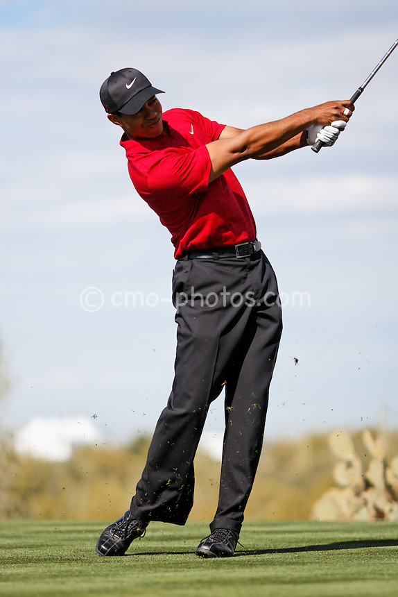 Feb 24, 2008; Marana, AZ, USA; Tiger Woods hits his tee shot on the 16th hole during his final-round match against Stewart Cink (not pictured) at the Accenture Match Play Championship at the Gallery Golf Club. Woods would go on to beat Cink 8 and 7 to earn his third victory in the WGC match play event and 15th victory overall in the World Golf Championship series.