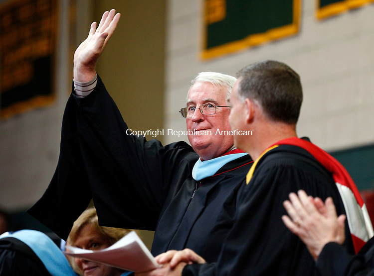 Waterbury, CT- 31 May 2015-053115CM05- Holy Cross High School president,  Timothy McDonald is acknowledged during commencement exercises at Holy Cross High School in Waterbury on Sunday.  Christopher Massa Republican-American