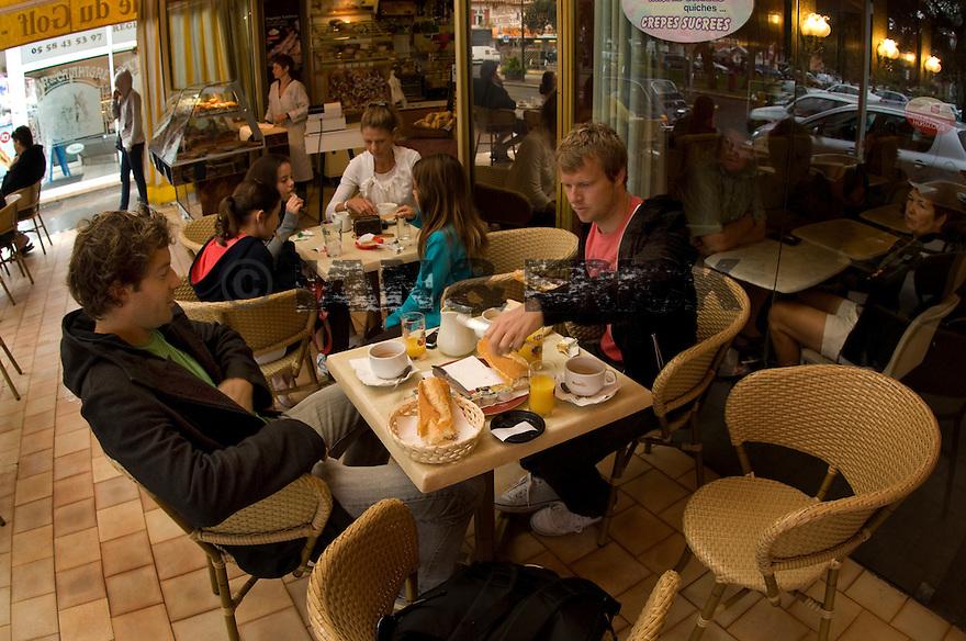 Taj + Luke having breakfast in Hossegor in the South of France.