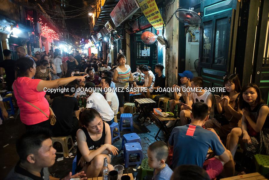 Nightlife in one of the streets of Hanoi (Vietnam)<br /> HANOI-VIETNAM