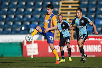 Jack Thomas of Mansfield Town controls the ball under pressure frm Luke O'Nien of Wycombe Wanderers (right) during the Sky Bet League 2 match between Wycombe Wanderers and Mansfield Town at Adams Park, High Wycombe, England on 25 March 2016. Photo by David Horn.