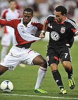 Dwayne De Rosario (7) of D.C. United goes against Doneil Henry (4) of Toronto FC. Toronto FC tied D.C. United 1-1, at RFK Stadium, Saturday August 24 , 2013.