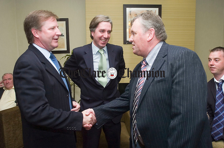 Special guest Ronnie Whelan and John Delaney, CEO of the FAI with Ger Kennedy club chairman at the Corofin Harps FC 40th anniversary celebrations at the West County hotel. Photograph by John Kelly.