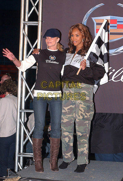 JAIME PRESSLY & VIVICA A. FOX.The 4th Annual Cadillac Celebrity Super Bowl Grand Prix held at the Michigan State Fairgrounds Coliseum, Detroit, Michigan, USA..February 4th, 2006.Photo: Jason Nelson/AdMedia/Capital Pictures.Ref: JN/ADM.full elngth jeans denim tucked into brown boots checkered flag hat black top jacket camouflage green trousers.www.capitalpictures.com.sales@capitalpictures.com.© Capital Pictures.