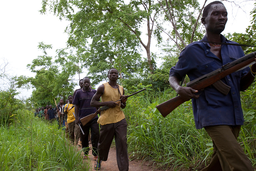 23 may 2010 - Western Equatoria State, South Sudan - Arrow Boys patrolling in Zangia, a village that was recently attacked by the LRA. Arrow boys groups are formed by local men and boys to defend their communities against LRA attacks with traditional weapons such as bows, arrows, spears and clubs, treated with poisonous and localy made guns. Western Equatoria state has been rocked by LRA activities since 2006. Thousands of people have been forced from their homes as brutal attacks continue against the civilian population in the region and neighboring DRC and CAR. Photo credit: Benedicte Desrus