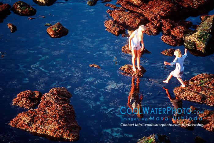 children explore tide pools at sunset, .La Jolla, San Diego, California (E. Pacific).