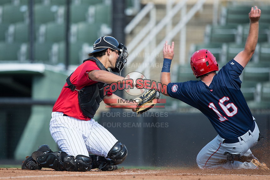 Sheldon Neuse (16) of the Hagerstown Suns is tagged out at home plate by Kannapolis Intimidators catcher Seby Zavala (21) at Kannapolis Intimidators Stadium on June 14, 2017 in Kannapolis, North Carolina.  The Intimidators defeated the Suns 4-1 in game one of a double-header.  (Brian Westerholt/Four Seam Images)