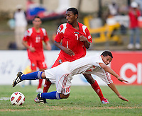 Frank Lopez (10) of Cuba falls to the ground in front of Dario Wright (7) of Panama during the group stage of the CONCACAF Men's Under 17 Championship at Jarrett Park in Montego Bay, Jamaica. Panama tied Cuba, 0-0.