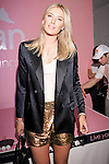 "Maria Sharapova arrives at the Evian ""Live Young"" photo shoot event she hosted at Openhouse Gallery on August 24, 2010."