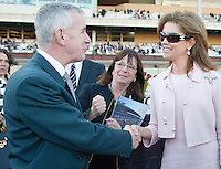 Michael Spiller (left), president of Genting New York, congratulates Lisa Troutt after WinStar horse  Gemologist won the Wood Memorial at Aqueduct Racetrack in Ozone Park, New York on Wood Memorial Day on April 7, 2012