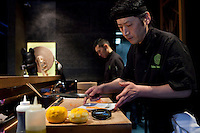 Head chef Takeo Yamazaki prepares salmon yuzu at Yoshi restaurant at the Metropole Hotel, Monaco, 23 March 2012