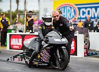 Mar 16, 2019; Gainesville, FL, USA; NHRA pro stock motorcycle rider Katie Sullivan and crew member during the Gatornationals at Gainesville Raceway. Mandatory Credit: Mark J. Rebilas-USA TODAY Sports
