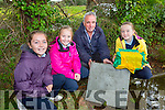 Corrina Griffin, Aoife Hickey and Kitty O'Dowd bury the time capsule in St Joesphs NS Castlemaine on Monday