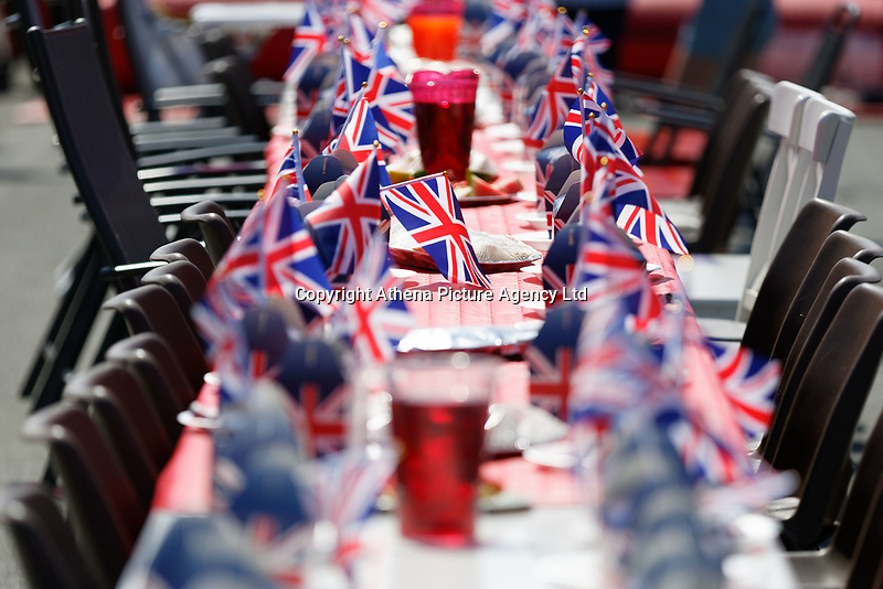 Pictured: British flag themed boxes and flags on the table at a street party in Cardiff. Saturday 19 May 2018<br /> Re: Prince Harry and Meghan Markle Royal Wedding Street Party at Avondale Crescent in Cardiff, Wales, UK.