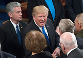 United States President Donald J. Trump greets members as he departs after delivering his first State of the Union address to a joint session of the US Congress in the US House chamber in the US Capitol in Washington, DC on Tuesday, January 30, 2018.<br /> Credit: Ron Sachs / CNP<br /> (RESTRICTION: NO New York or New Jersey Newspapers or newspapers within a 75 mile radius of New York City)