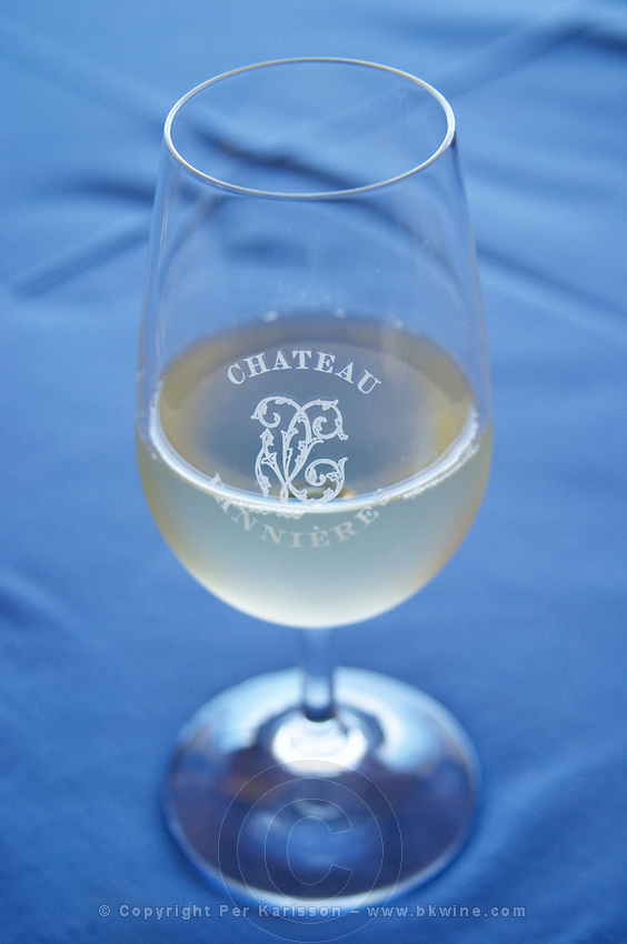 Glass of white wine with the text Chateau Vannieres against a blue table cloth Chateau Vannieres (Vannières) La Cadiere (Cadière) d'Azur Bandol Var Cote d'Azur France