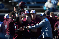 Jakob Divers (2) of the Concord Mountain Lions is congratulated by his teammates after having hit a home run against the Wingate Bulldogs at Ron Christopher Stadium on February 2, 2020 in Wingate, North Carolina. The Mountain Lions defeated the Bulldogs 12-11. (Brian Westerholt/Four Seam Images)