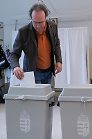 Man casts his vote during the European Parliamentary election in Budapest, Hungary on May 26, 2019. ATTILA VOLGYI