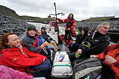 Competitors and spectators head for the World Stone Skimming Championships on Easdale which attracted over 300 entries from all round the world - Easdale is reached by a small open ferry-boat from the Isle of Seil - south of Oban - picture by Donald MacLeod - 25.9.11 - clanmacleod@btinternet.com 07702 319 738 donald-macleod.com