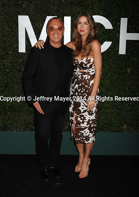 BEVERLY HILLS, CA- OCTOBER 02: Designer Michael Kors (L) and photographer Claiborne Swanson Frank arrive at the Michael Kors Hosts Launch Of Claiborne Swanson Frank's 'Young Hollywood' Portrait Book at a private residence on October 2, 2014 in Beverly Hills, California.