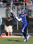 Carson's Mathias Williams catches a kick off during the NIAA D-1 Northern Regional title game against Reed at Bishop Manogue High School in Reno, Nev., on Saturday, Nov. 29, 2014. Reed won 28-25.<br /> Photo by Cathleen Allison