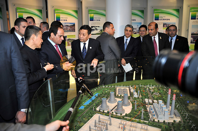 A handout picture released by Egyptian Presidency shows Egyptian President Abdel Fattah El-Sisi visit Sichuan city, China, December 26, 2014. President Abdel Fattah El Sisi has concluded his visit of China after touring the key industrial city of Sichuan, Sisi urged Chinese companies in Sichuan to seek investment opportunities in Egypt and called for promoting tourism from the city to Egypt. Photo by Egyptian Presidency