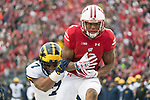 Wisconsin Badgers wide receiver A.J. Taylor (4) catches a touchdown pass during an NCAA College Big Ten Conference football game against the Michigan Wolverines Saturday, November 18, 2017, in Madison, Wis. The Badgers won 24-10. (Photo by David Stluka)
