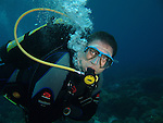 Shi Lang, Green Island -- Diver with a free-flowing regulator.