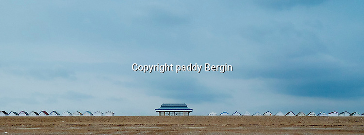 A Pavilion on Worthing promenade situated between Beach Huts.<br /> <br /> Stock Photo by Paddy Bergin