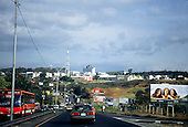 Costa Rica. Traffic on a main dual carriageway highway with factories and advertising hoardings.