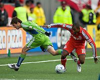 Brad Evans (left)  of the Seattle Sounders FC and Marvell Wynne (16) of Toronto FC in MLS action at BMO Field on April 4, 2009.Seattle won 2-0.