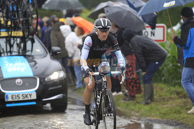 Riders including Matthew Busche (USA) Trek Factory Racing tackle the1st cobbled sector 9  from Gruson to Crossroads de l'Arbe during Stage 5 of the 2014 Tour de France running 155.5km from Ypres to Arenberg. 9th July 2014.<br /> Picture: Eoin Clarke www.newsfile.ie