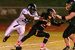 WATERTOWN, CT. 11 October 2019-101119BS387 - Ansonia's Cyril Jack #56, left, grabs Watertown quarterback Xavier Powell (12) for a sack deep in the Watertown end of the field, during a NVL game of the unbeatens between Ansonia and Watertown at Watertown High School on Friday. Bill Shettle Republican-American