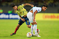 PEREIRA, COLOMBIA - JANUARY 18: Colombia's Jorge Carrascal, (R) fights for the ball against Argentina's Nazareno Colombo during their CONMEBOL Preolimpico soccer game at the Hernan Ramirez Villegas Stadium on January 18, 2020 in Pereira, Colombia. (Photo by Daniel Munoz/VIEW press/Getty Images)