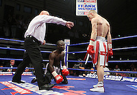 Michael Walsh (Cromer, Norfolk, red/white shorts) defeats Isaac Owusu (Ghana, black shorts) in a Super-Bantamweight boxing contest at York Hall, Bethnal Green, promoted by Frank Warren / Sports Network - 22/05/09 - MANDATORY CREDIT: Gavin Ellis/TGSPHOTO - Self billing applies where appropriate - 0845 094 6026 - contact@tgsphoto.co.uk - NO UNPAID USE.