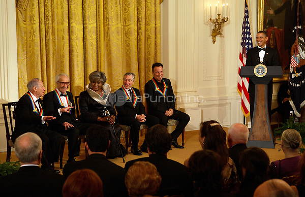 Washington, DC - December 6, 2009 -- United States President Barack Obama hosts the 2009 Kennedy Center Honorees at an East Room reception in the White House in Washington, D.C. on Sunday, December 6, 2009. Shown with the president on stage are (l-r) honorees Mel Brooks, Dave Brubeck, Grace Bumbry, Robert DeNiro, and Bruce Springsteen. <br /> Credit: Martin H. Simon / Pool via CNP /MediaPunch